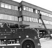 The fire brigade attending a fire at BBC Radio Oxford, Summertown, Oxford, 1971