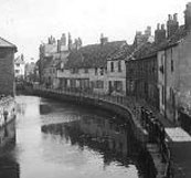 Lower Fisher Row, Oxford, beside Castle Mill Stream - people outside the houses, 1927